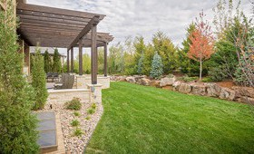 A beautiful gravel and wooden patio