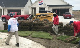 Adding sod to the front lawn of a house