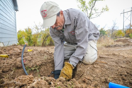 TenderCare employee installing irrigation lines