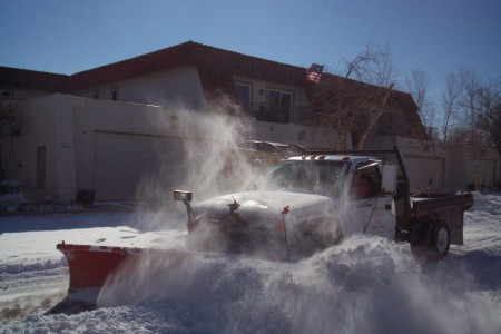 TenderCare employee using a plow to remove snow