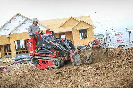 TenderCare employee using heavy machinery to dig